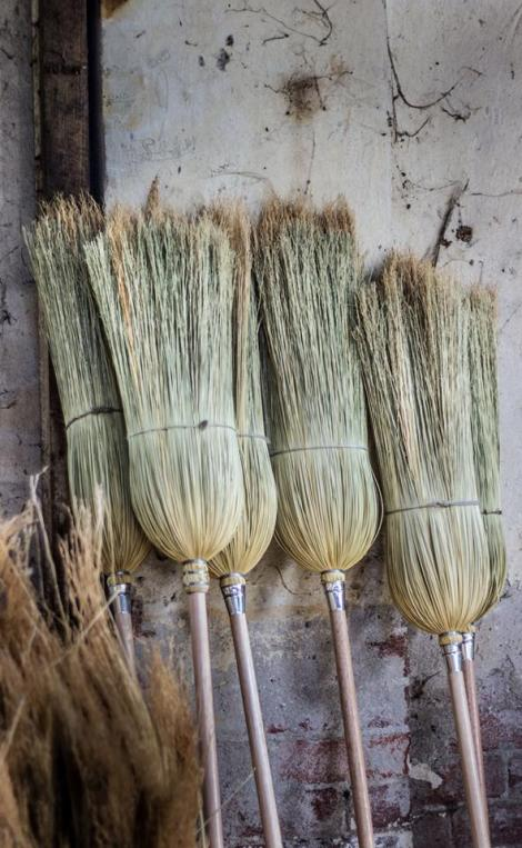 Brooms on wall