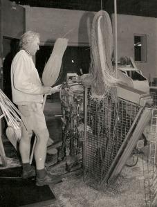 Geoff Wortes stitching a broom on teh sewing machine